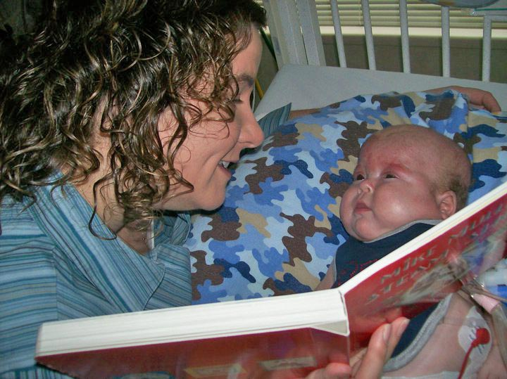Mom reading book to her baby